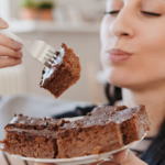 woman eating plate of brownies | how much is too much sugar