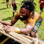 man climbing rugged maniac rope wall | openfit rugged maniac