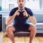man doing kettlebell squat at home | kettlebell squats