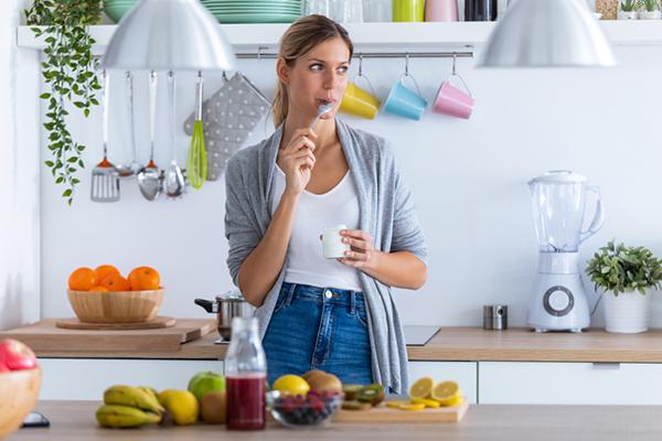 pensive woman eating breakfast | skipping breakfast