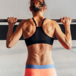 woman doing pull ups | bodyweight back exercises