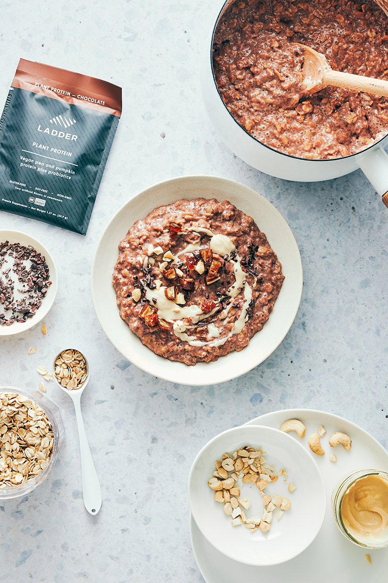 bowl of chocolate cashew butter oatmeal with ingredients | chocolate and cashew butter oatmeal