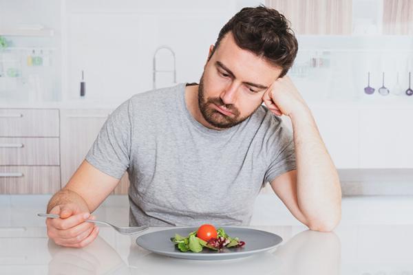 sad man looking at vegetables | foods you should never eat