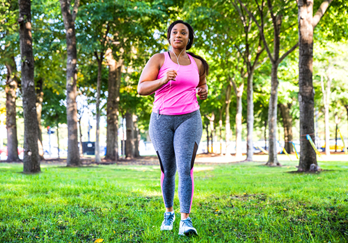 woman walking in park   active recovery