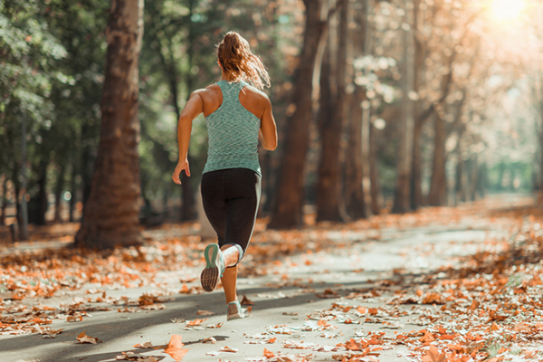 woman running outdoors   active recovery