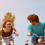 couple biking together   active recovery