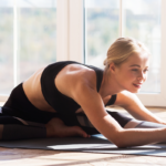 woman stretching at home | openfit live pilates