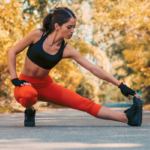 athletic woman stretching with trees in background | workout schedule