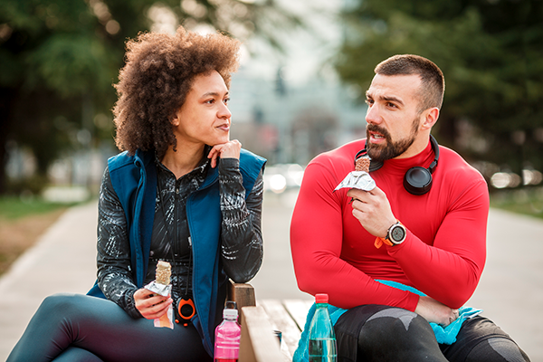 couple snacking after workout   calories to maintain weight