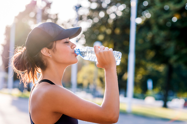 athletic woman drinking water | hydration supplements