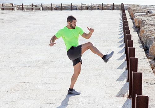 man kicking leg up | how to increase flexibility