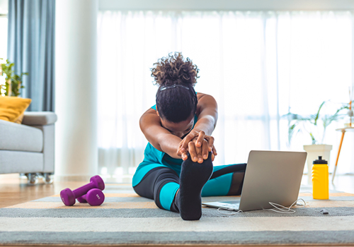 woman holding static leg stretch | how to increase flexibility