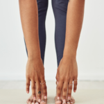 unpictured woman touching her toes | how to increase flexibility
