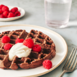 plated double chocolate waffle with fruit and yogurt topping | chocolate waffle