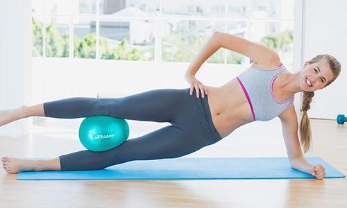 woman using barre ball | best butt workout tools