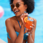 woman enjoying mocktail poolside | non alcoholic cocktails