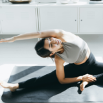 woman stretching on yoga mat at home   does stretching burn calories