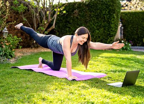 woman doing yoga on lawn