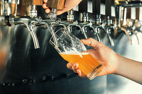 pouring a glass of beer from tap | quitting sugar