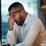 man yawning at work | sleep and weight gain