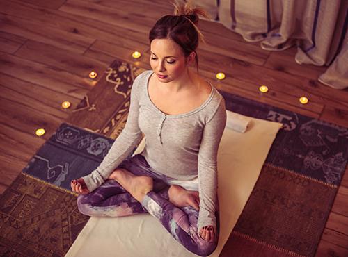 woman meditating | how to fall asleep and stay asleep