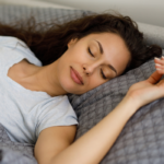 woman sleeping peacefully in bed | how to fall asleep and stay asleep