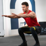 joey thurman doing resistance band squat | full body resistance band workout