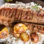 steak and potatoes on top of rice   vertical diet