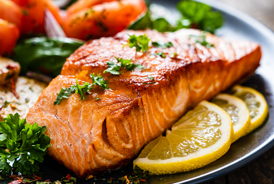 cooked salmon with herbs and vegetables | food allergies