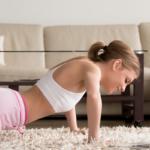 woman doing knee push ups at home   knee push ups