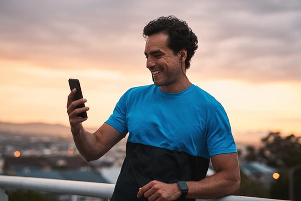 man smiling at his phone