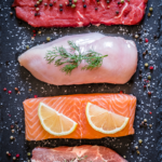 four types of meat on cutting board | amino acids
