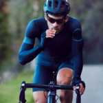 cyclist eating a sports bar while riding | cycling diet