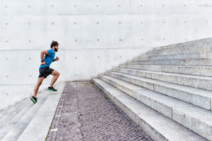 Man running up stairs outside | hip pain running