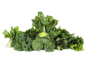 pile of leafy green vegetables--what to eat to lose weight