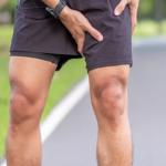 man clutching leg after run--avoid exercise injury