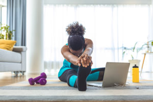 Woman stretching after her workout--avoid exercise injury