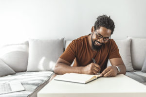 man journaling--running motivation