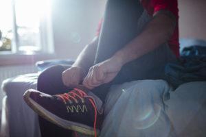 putting on running shoes--running motivation