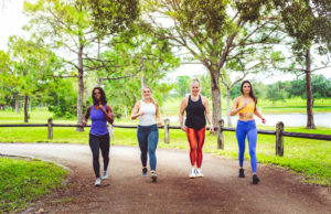 group of friends on a walk outside--running motivation