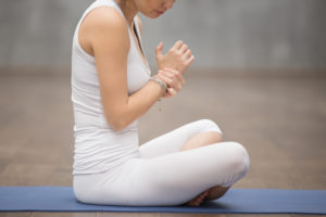woman holding wrist after working out -- weak wrist