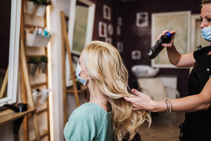 woman getting hair done | how to treat yourself