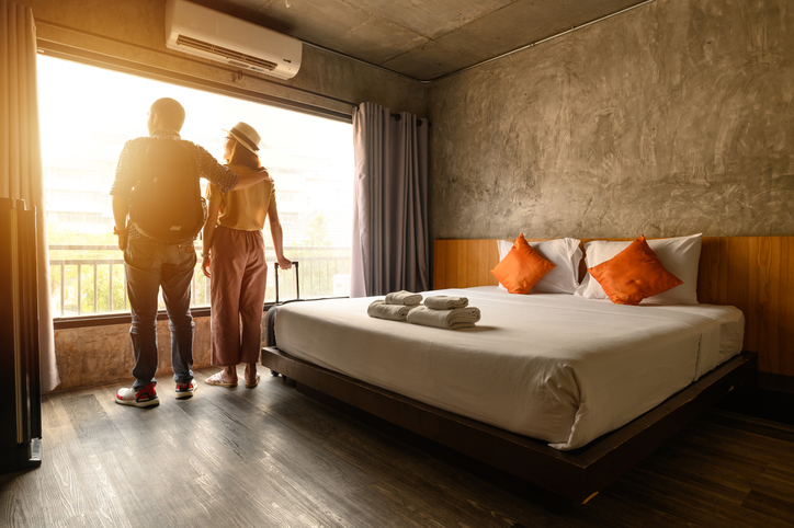 couple on balcony of hotel room | how to treat yourself