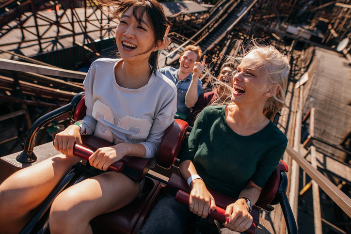 two women riding rollercoaster | how to treat yourself