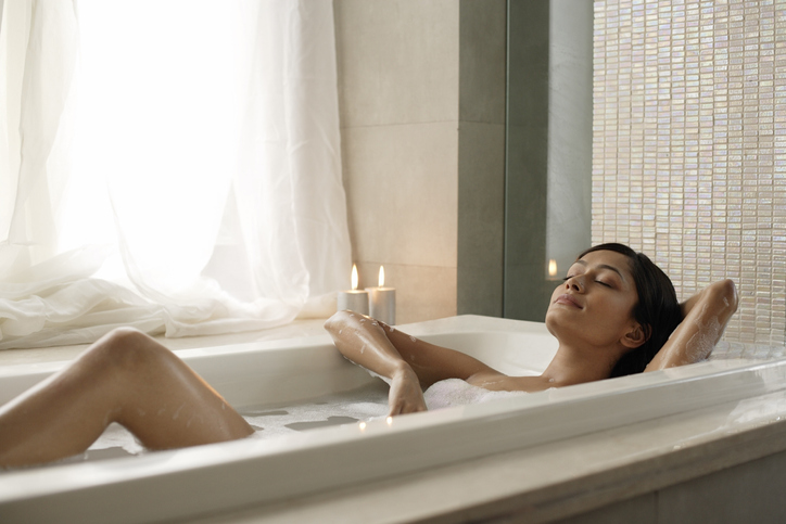 woman relaxing in bath | how to treat yourself