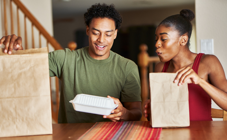 couple eating takeout | how to treat yourself