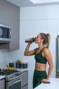 Kelsey Heenan drinking protein shake LADDER
