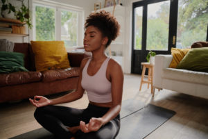 woman meditating -- how to avoid burnout