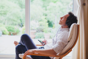 man listening to guided meditation -- how often should you meditate