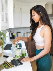 woman making an iced vanilla latte